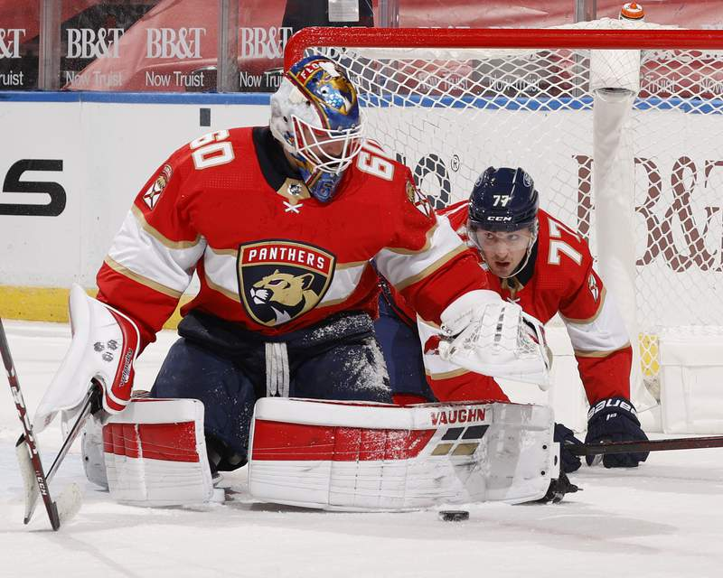 Frank Vatrano looks out from the net as Goaltender Chris Driedger of the Florida Panthers stops a shot by the Chicago Blackhawks at the BB&T Center on January 17, 2021 in Sunrise, Florida.