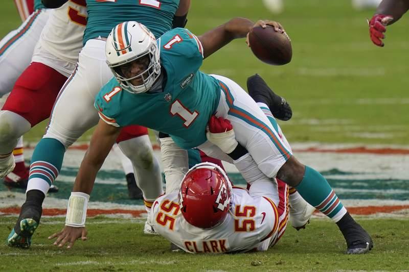Kansas City Chiefs defensive end Frank Clark (55) sacks Miami Dolphins quarterback Tua Tagovailoa (1), during the first half of an NFL football game, Sunday, Dec. 13, 2020, in Miami Gardens, Fla. (AP Photo/Lynne Sladky)
