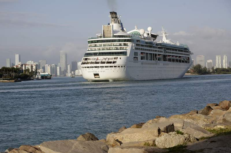 FILE - In this Monday, Feb. 5, 2018 file photo, Royal Caribbean's Grandeur of the Seas comes into the Port of Miami in Miami Beach, Fla. Royal Caribbean International said Friday, June 4, 2021 that eight of its ships will resume U.S. voyages in July and August with trips leaving ports in Florida, Texas and Washington state.  The cruise line said all crew members will be vaccinated against COVID-19. (AP Photo/Lynne Sladky, File)