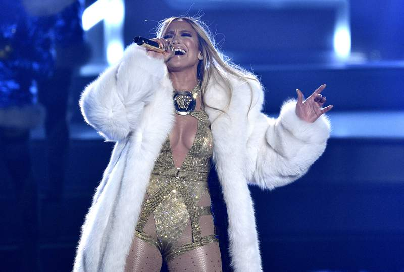 """FILE - Video Vanguard award recipient Jennifer Lopez performs at the MTV Video Music Awards in New York on Aug. 20, 2018.  Lopez will help bring in the New Year with a headlining performance in New Yorks Time Square for Dick Clarks New Years Rockin Eve with Ryan Seacrest 2021."""" ABC and dick clark productions announced Tuesday that the pop star will perform live before the icon ball drop on Dec. 31. Because of the coronavirus pandemic, the event will be closed to the public. (Photo by Chris Pizzello/Invision/AP, File)"""