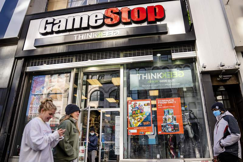 FILE - In this Jan. 28, 2021, file photo, pedestrians pass a GameStop store on 14th Street at Union Square, in the Manhattan borough of New York. Wall Streets mania over GameStop is on again, at least for one afternoon. Shares in the troubled video game company more than doubled Wednesday, Feb. 24, 2021 to $91.71 apiece, the stocks best day since Jan. 27, when it was going for $347.51 a share. (AP Photo/John Minchillo, File)