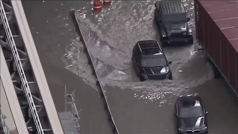 Vacuum trucks clear water after Miami streets flood in Downtown, Brickell