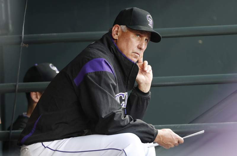 FILE - In this Aug. 27, 2019, file photo, Colorado Rockies manager Bud Black watches during the first inning of the team's baseball game against the Boston Red Sox in Denver. Black said in a conference call Thursday, March 19, that he would be open to the idea of doubleheaders. Opening day has been pushed back from March 26 to mid-May at the earliest, and both sides are committed to playing as many games as possible. (AP Photo/David Zalubowski, File)
