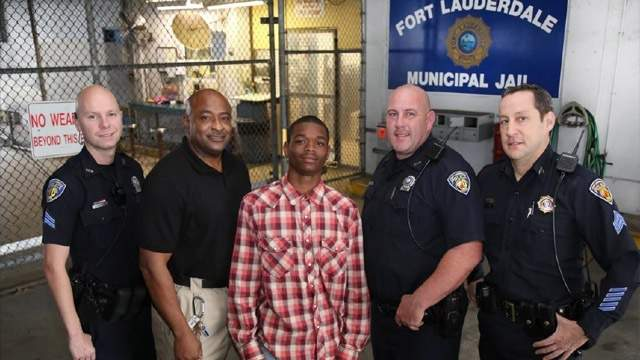 Jamal Rutledge (center) commended for helping to save the life of Officer Franklin Foulks (second from left)