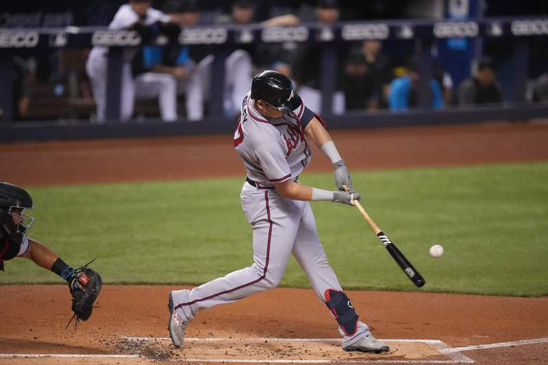Austin Riley of the Atlanta Braves hits a home run in the third inning against the Miami Marlins at loanDepot park on June 13, 2021 in Miami, Florida. (Photo by Mark Brown/Getty Images)