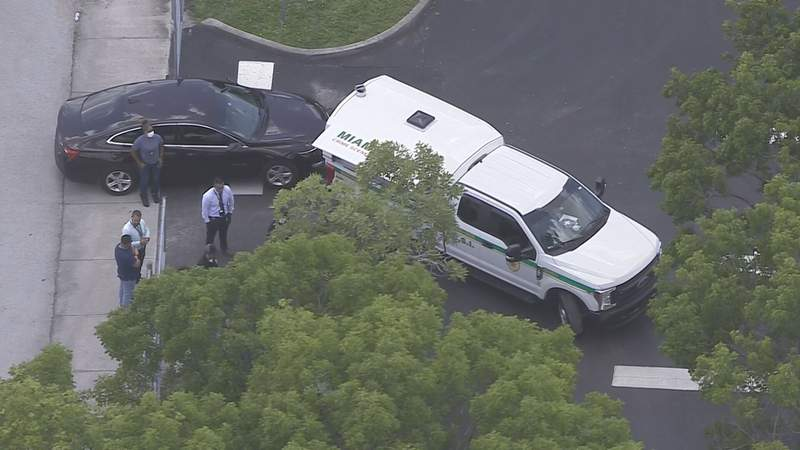 Investigators are outside Lake Stevens Middle School in Miami Gardens where a body was reportedly found Friday.