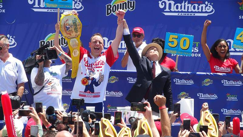 Defending Champion Joey Chestnut wins after consuming 76 hot dogs and setting a new world record at the 2021 Nathan's Famous International Hot Dog Eating Contest. Photo by Bobby Bank/WireImage