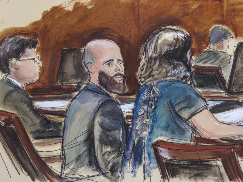 FILE - In this Wednesday, March 4, 2020, courtroom sketch, Joshua Schulte, center, is seated at the defense table flanked by his attorneys during jury deliberations in New York. A judge says Schulte, a former CIA employee, cannot get espionage charges against him dismissed on the grounds that there weren't enough Hispanic or Black individuals on the grand jury that indicted him. (Elizabeth Williams via AP, File)