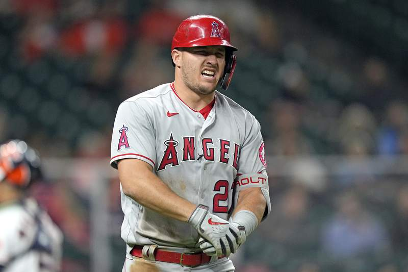 Los Angeles Angels' Mike Trout reacts after being hit by a pitch thrown by Houston Astros' Cristian Javierp during the fourth inning of a baseball game Thursday, April 22, 2021, in Houston. (AP Photo/David J. Phillip)
