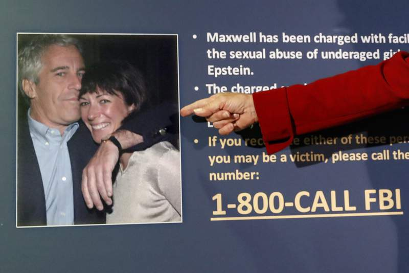 FILE - Audrey Strauss, acting United States Attorney for the Southern District of New York, points to a photo of Jeffrey Epstein and Ghislaine Maxwell during a news conference, July 2, 2020, in New York. Transcripts of interviews lawyers conducted with Maxwell, the ex-girlfriend of the late convicted sex offender Jeffrey Epstein, should be released as soon as possible, a judge ordered on Tuesday, Oct. 20, 2020.  U.S. District Judge Loretta A. Preska said the transcripts of two days of depositions in 2016 of the British socialite and related documents along with the deposition transcript of an anonymous accuser should be released publicly as soon as is practicable. (AP Photo/John Minchillo, File)