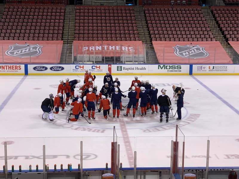 Florida Panthers head coach Joel Quenneville speaks to his players following a practice at the BB&T Center on January 22, 2021.