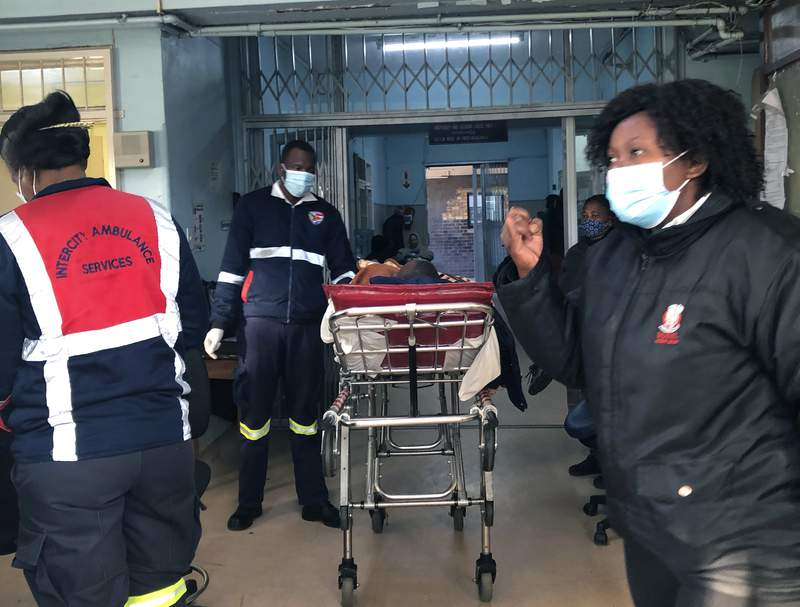 A COVID-19 patient is admitted to a hospital in Johannesburg, Wednesday, June 23, 2021. South Africa's third wave of COVID-19 infections is overwhelming the health system in Gauteng, the country's most populous province that is now running out of beds to treat patients. (AP Photo)