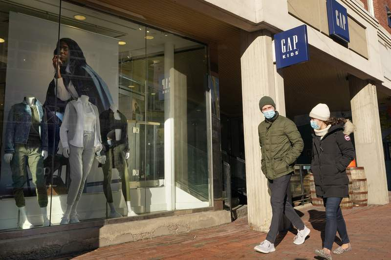 Passers-by walks near an entrance to a Gap clothing store, Thursday, Feb. 25, 2021, in Cambridge, Mass.  Bouncing back from months of retrenchment, Americas consumers stepped up their spending by a solid 2.4% in January in a sign that the economy may be making a tentative recovery from the pandemic recession. Fridays report from the Commerce Department also showed that personal incomes, which provide the fuel for spending, jumped 10% last month, boosted by cash payments most Americans received from the government. (AP Photo/Steven Senne)
