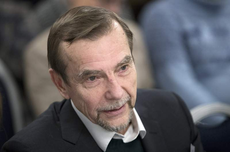 FILE- In this file photo taken on Monday, Dec. 12, 2016, Russian human rights activist Lev Ponomarev attends an annual meeting of opposition and human rights activists in Moscow, Russia. A longtime Russian human rights organization has announced it is disbanding due to pressure from the country's foreign agents law. The organization For Human Rights said in a statement Sunday March 7, 2021, that it was disbanding, citing the inclusion of its leader Lev Ponomarev on the Justice Ministry's list of foreign agents. (AP Photo/Pavel Golovkin, File)
