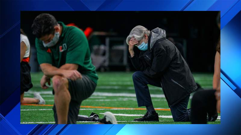 University of Miami President Dr. Julio Frenk and football head coach Manny Diaz join other head coaches and student athletes in a silent protest of the death of George Floyd. The protest took place inside the football team's indoor practice facility, on the school's campus in Coral Gables, Florida.