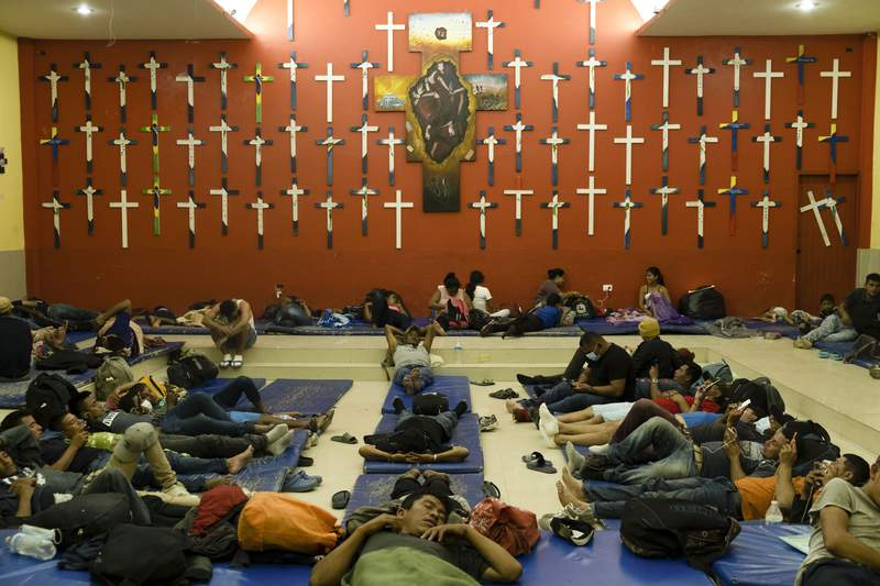 Central American migrants rest at La 72 shelter in Tenosique, Tabasco state, Mexico, Tuesday, Feb. 9, 2021. When Guatemalan authorities blocked a migrant caravan last month drawing international attention the flow of migrants might have seemed to slow down, but a growing number of small groups continue to flow daily from Central America into Mexico. (AP Photo/Isabel Mateos)