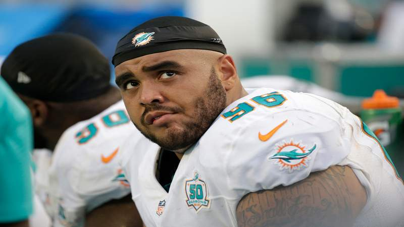 Miami Dolphins defensive tackle A.J. Francis looks at the scoreboard during the second half of a game against the Buffalo Bills, Sept. 27, 2015, in Miami Gardens, Florida.