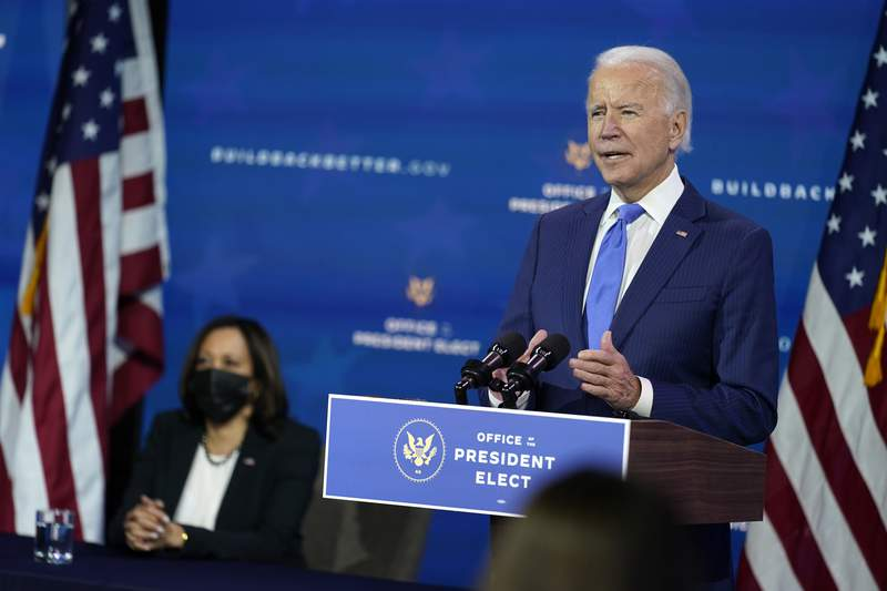 In this Dec. 1, 2020, photo, President-elect Joe Biden speaks as Vice President-elect Kamala Harris listens at left, during an event to introduce their nominees and appointees to economic policy posts at The Queen theater in Wilmington, Del. Up soon for Biden: naming his top health care officials as the coronavirus pandemic rages. Its hard to imagine more consequential picks. Biden is expected to announce his choice to head the Department of Health and Human Services next week. (AP Photo/Andrew Harnik)