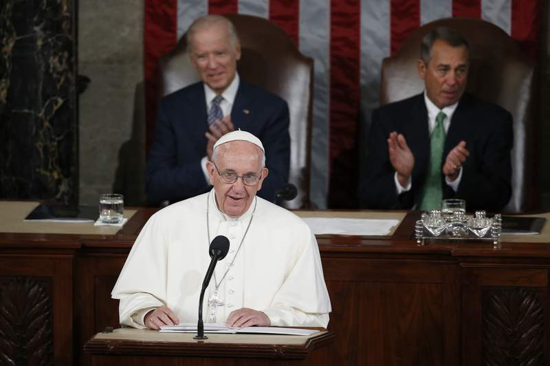 FILE - In this Thursday, Sept. 24, 2015 file photo, Pope Francis addresses a joint meeting of Congress on Capitol Hill in Washington, making history as the first pontiff to do so. Listening behind the pope are Vice President Joe Biden and House Speaker John Boehner of Ohio. President-elect Joe Biden, a lifelong Roman Catholic, spoke to Pope Francis on Thursday, Nov. 12, 2020, despite President Donald Trump refusing to concede. Trump claims  without evidence  that the election was stolen from him through massive but unspecified acts of fraud. (AP Photo/Carolyn Kaster)