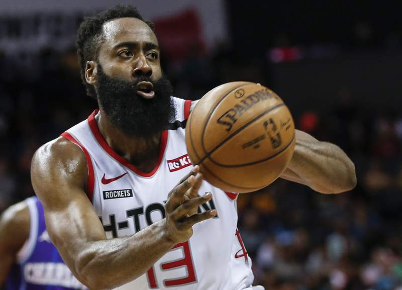 FILE - In this Saturday, March 7, 2020, file photo, Houston Rockets guard James Harden passes against the Charlotte Hornets during the second half of an NBA basketball game in Charlotte, N.C. Harden practiced with his teammates for the first time this summer, Thursday, July 16, 2020, after arriving later than most of the Rockets for the season restart at Walt Disney World. (AP Photo/Nell Redmond, File)