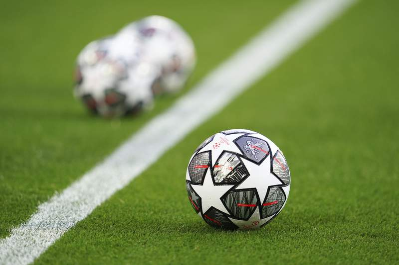 The Official UEFA Champions League match balls are on display ahead of the Champions League quarter final second leg soccer match between Liverpool and Real Madrid at Anfield stadium in Liverpool, England, Wednesday, April 14, 2021. (AP Photo/Jon Super)