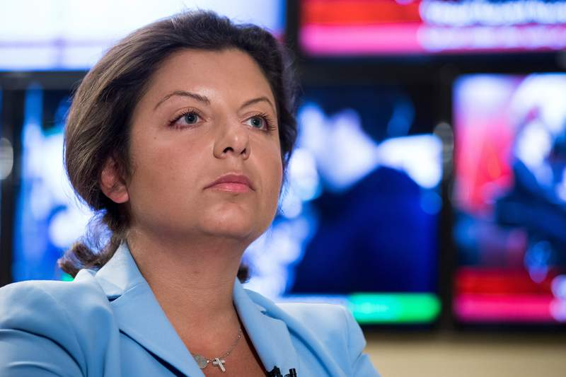 """FILE - In this Jan. 19, 2018, file photo, Margarita Simonyan, the head of the Russian television channel RT, listens to a question during her interview with the Associated Press in Moscow, Russia. YouTube says it has shut two German channels of Russian state broadcaster RT in a move centering on alleged coronavirus misinformation, a decision that drew threats of retaliation from Russia on Wednesday, Sept. 29, 2021. Writing on the messaging app Telegram, RT Editor-in-Chief Margarita Simonyan called the move """"a true media war"""" by Germany on Russia. (AP Photo/Alexander Zemlianichenko, File)"""
