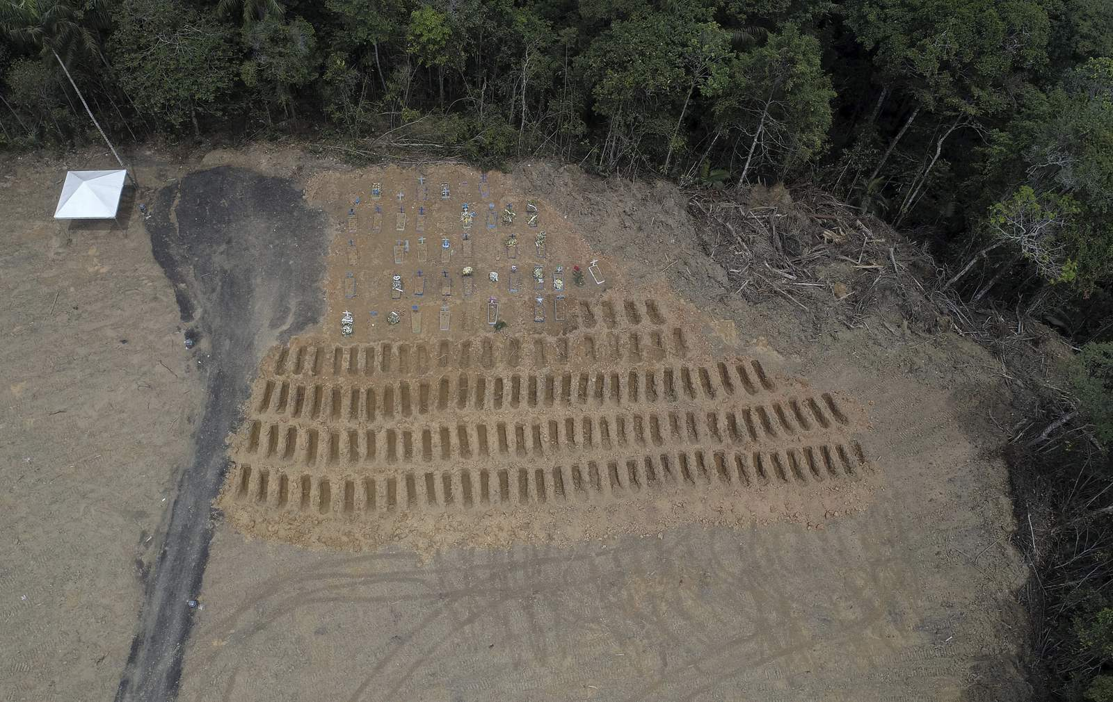 Freshly dug graves are seen at the Nossa Senhora Aparecida cemetery, amid the new coronavirus pandemic in Manaus, Amazonas state, Brazil, Wednesday, April 22, 2020. (AP Photo/Emerson Cardoso)