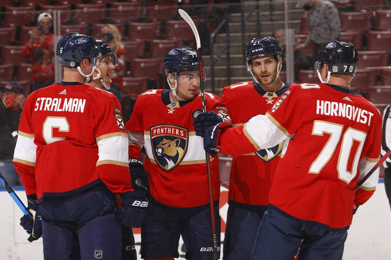 Teammates celebrate with Frank Vatrano of the Florida Panthers after he scores an unassisted goal against the Columbus Blue Jackets in the first period at the BB&T Center on April 19, 2021 in Sunrise, Florida.