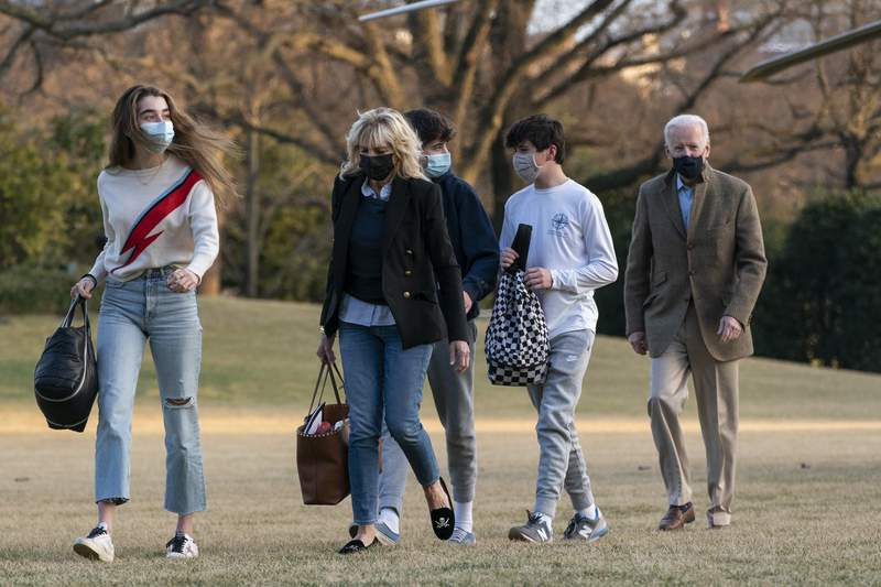 President Joe Biden and first lady Jill Biden with their grandchildren Natalie Biden and Hunter Biden, walk on the South Lawn upon arrival at the White House in Washington from a weekend trip to Wilmington, Del., Sunday, March 14, 2021. (AP Photo/Manuel Balce Ceneta)