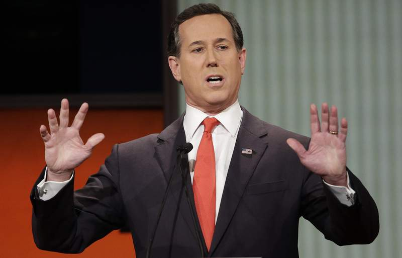 FILE - Republican presidential candidate, former Pennsylvania Sen. Rick Santorum speaks during the Fox Business Network Republican presidential debate in North Charleston, S.C. on Jan. 14, 2016. The CNN analyst went on the network to try and explain comments about Native Americans that have led to criticism, but didn't appear to calm things down. Santorum told a group of young conservative last month that there was nothing here when immigrants founded the United States. That angered Native Americans and others. He said on CNN Monday that he was speaking in context of the U.S. government's creation and didn't mean to minimize treatment of Native Americans. (AP Photo/Chuck Burton, File)