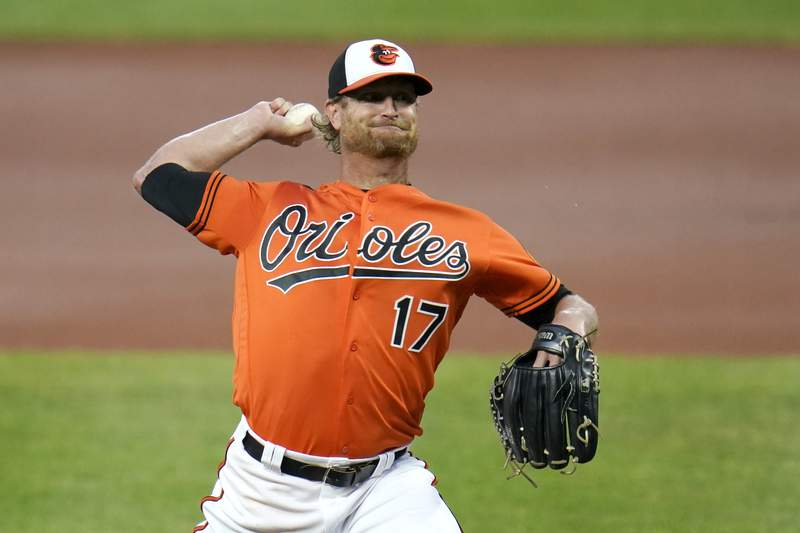 FILE - In this Saturday, Aug. 22, 2020 file photo, Baltimore Orioles starting pitcher Alex Cobb throws a pitch to the Boston Red Sox during the first inning of a baseball game in Baltimore. The Los Angeles Angels have acquired veteran right-hander Alex Cobb from the Baltimore Orioles in a trade for prospect Jahmai Jones, Tuesday, Feb. 2, 2021. (AP Photo/Julio Cortez, File)