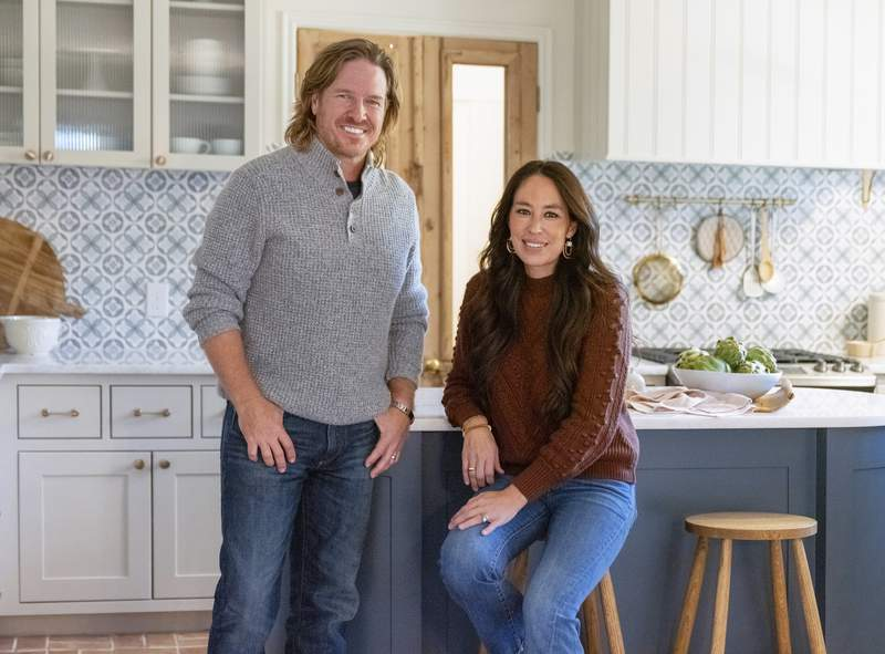 """This image released by Magnolia Network shows Chip and Joanna Gaines from the sixth season of """"Fixer Upper."""" Magnolia Network, a joint venture between the Gaines' and Discovery, Inc. will launch on July 15. (Lisa Petrole/Magnolia Network via AP)"""