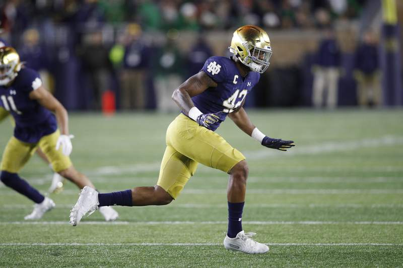 Julian Okwara #42 of the Notre Dame Fighting Irish in action on defense during a game against the USC Trojans at Notre Dame Stadium on October 12, 2019 in South Bend, Indiana. Notre Dame defeated USC 30-27.