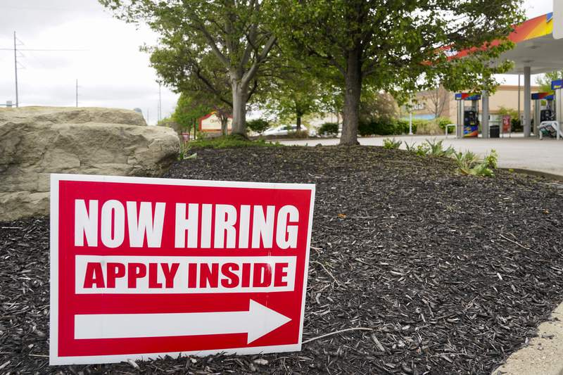 Hiring signs are posted outside a gas station in Cranberry Township, Butler County, Pa., Wednesday, May 5, 2021.  The U.S. Chamber of Commerce is calling for Washington to immediately stop paying out-of-work Americans an extra $300 a week in unemployment benefits, Friday, May 7, saying the boost in government aid is giving some recipients less incentive to look for work. (AP Photo/Keith Srakocic)