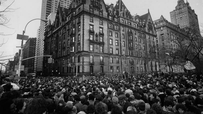 Crowds gathering outside the home of John Lennon in New York after the news that he had been shot and killed. Photo by Keystone.