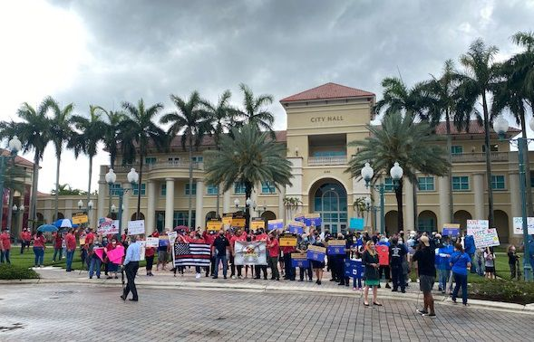 Protesters line up in front of Miramar City Hall where city leaders will be debating furloughs to every city worker including police and firefighters.