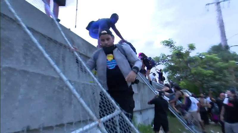 Protesters climb fence in Miami to get onto Interstate 95