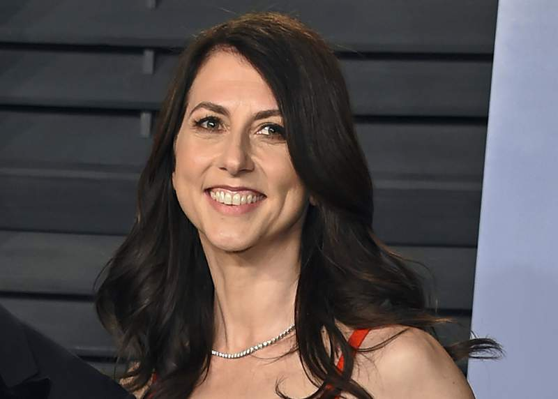 FILE - In this March 4, 2018, file photo, then-MacKenzie Bezos arrives at the Vanity Fair Oscar Party in Beverly Hills, Calif. MacKenzie Scott stormed the philanthropy world in 2020 with $5.7 billion in unrestricted donations to hundreds of charities. The seven- and eight-figure gifts were the largest many had ever received. At the time, few people understood the multiplier effect those gifts would have or how truly wide a net she was casting. (Photo by Evan Agostini/Invision/AP, File)