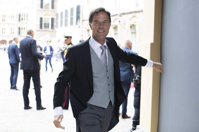 -FILE- In this Tuesday Sept. 17, 2019, file image, Dutch Prime Minister Mark Rutte arrives at the Knight's Hall in The Hague, Netherlands. Dutch Prime Minister Mark Rutte eased his country's coronavirus measures Tuesday Nov. 17, 2020, amid falling infection rates, allowing public venues including cinemas, museums and libraries to re-open after a two-week closure. However, Rutte warned that the country must remain in a partial lockdown he imposed in mid-October when Dutch rates of infections were among the worst in Europe. (AP Photo/Peter Dejong)