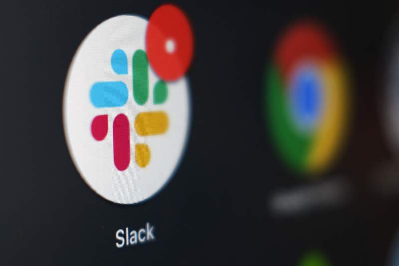 File-This Dec. 2, 2020, file photo shows the Slack app icon being displayed on a computer screen in Tokyo. Slack suffered a global outage Monday, Jan. 4, 2021,  during the first day back to work for most people after the New Years holiday. Users reported service was down in the U.S., Asia, Latin America Europe, and India.  (AP Photo/Kiichiro Sato, File)