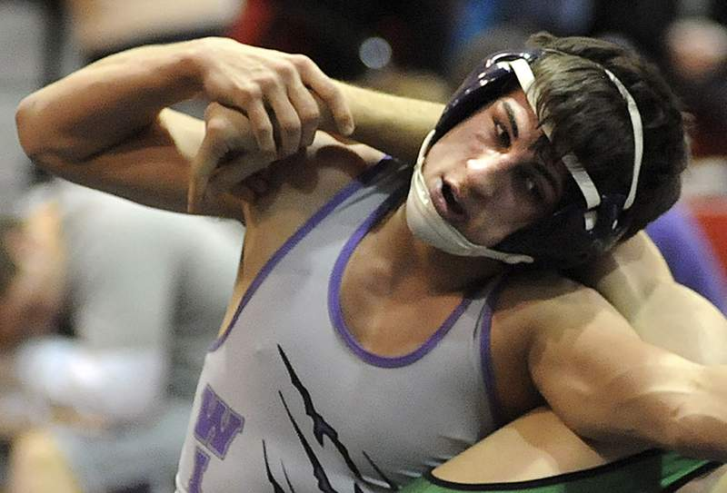 FILE-This Jan. 16, 2014 file photo shows Keystone High School Logan Stiner during a wrestling match in Sheffield Village, Ohio. The coroner said Stiner, who died May 27, 2014, had more than 70 micrograms of caffeine per milliliter of blood in his system.  The Ohio Supreme Court plans Wednesday, April 29, 2020 to hear arguments for and against a lawsuit brought by Stiner's family arguing that Amazon, the online retail giant, as the company that shipped the product, should be held responsible under Ohio product liability law.  (AP Photo/Steve Manheim, The Chronicle Telegram, File)