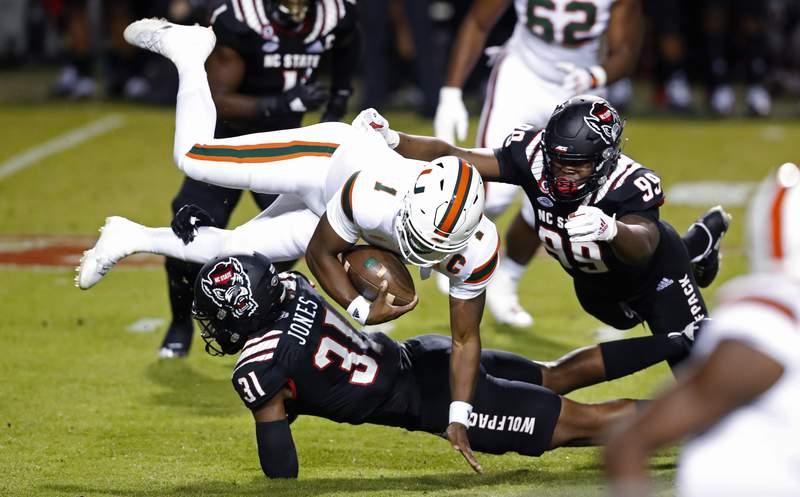 North Carolina State linebacker Vi Jones takes down Miami quarterback D'Eriq King during the first half of a game Nov. 6 in Raleigh, N.C.