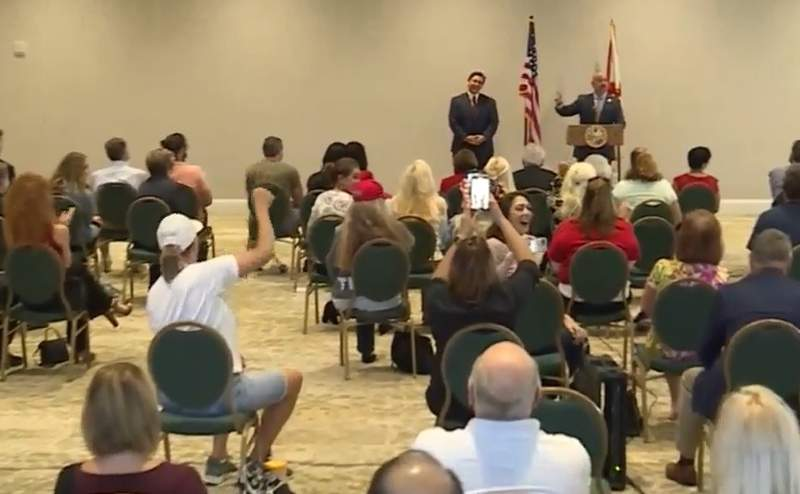 Florida Gov. Ron DeSantis hosts an event to discuss election legislation Friday morning. By Friday afternoon, the hotel was given a warning for people at the event not following the county's mask mandate in West Palm Beach.