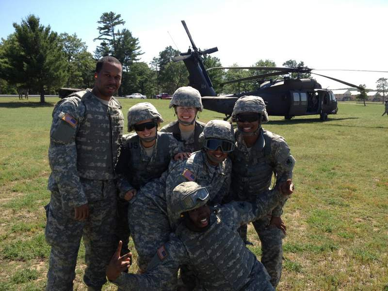 A group of U.S. Army soldiers gather at Annual Training before getting on a helicopter. Pictured: Maximillian Boudreaux, Cynthia Horvath, Anna Banister, Joseph Reynolds, Yvette Bass and Ashley Hudson.