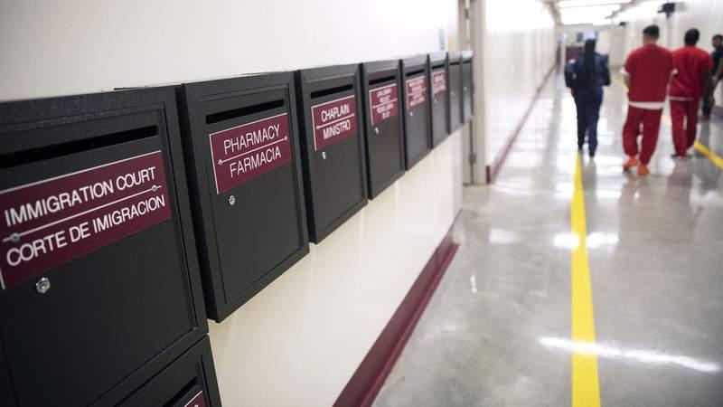 Mail boxes for various departments line a hallway as detainees walk through the Stewart Detention Center, Friday, Nov. 15, 2019, in Lumpkin, Ga. AP Photo/David Goldman
