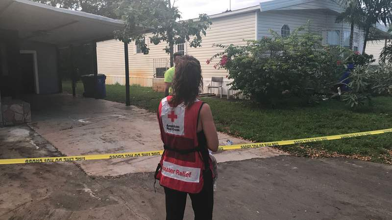 Red Cross volunteers respond Thursday to the Highland Village Mobile Park in Pompano Beach.