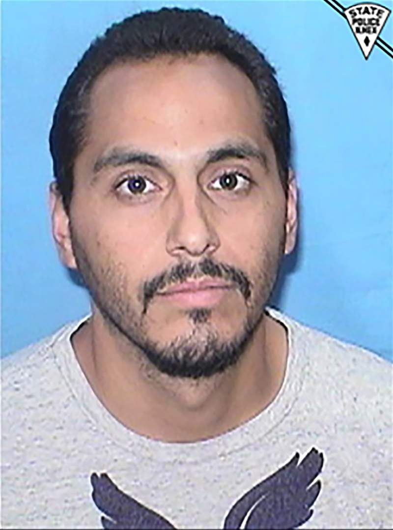 This booking photo released by the New Mexico State Police shows Armando Zamora on Oct. 3, 2021. Zamora, who was on probation, and had to wear an ankle bracelet to monitor his movements, was arrested in the fatal beating of his wife with an ax after authorities used data from the bracelet to find her body in a national forest where the couple went to cut firewood, state police said Wednesday, Oct. 6. (New Mexico State Police via AP)