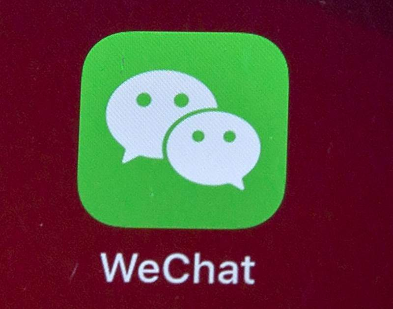 In this Aug. 7, 2020, file photo, icons for the smartphone app WeChat is seen on a smartphone screen in Beijing. Chinas most popular social media service has deleted accounts on LGBT topics run by university students and nongovernment groups, prompting concern the ruling Communist Party is tightening control over gay and lesbian content. (AP Photo/Mark Schiefelbein, File)