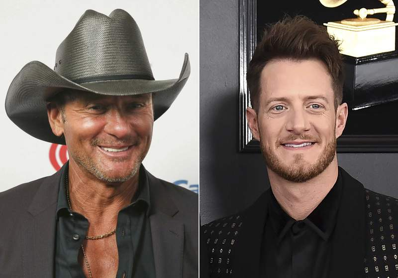 """This combination photo shows Tim McGraw at the iHeartCountry Festival in Austin, Texas on May 4, 2019, left, and Tyler Hubbard of the duo Florida Georgia Line at the 61st annual Grammy Awards in Los Angeles on Feb. 10, 2019. Hubbard and McGraw are asking people to walk a mile in someone else's shoes in a call for unity on their new duet Undivided."""" Hubbard wrote the song while isolating on his tour bus after testing positive for COVID-19 last year. He said the division in America in 2020 weighed heavily on his heart as he wrote the song. McGraw said the song isn't political, but makes a case for empathy instead of disagreement. (AP Photo)"""
