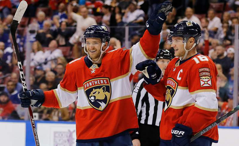 Jonathan Huberdeau of the Florida Panthers celebrates with Aleksander Barkov after assisting a goal which made him the the all-time Florida Panthers leader in points during the third period against the Toronto Maple Leafs at BB&T Center on January 12, 2020 in Sunrise, Florida.